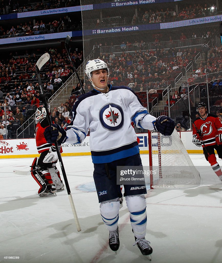 <a gi-track='captionPersonalityLinkClicked' href=/galleries/search?phrase=Mark+Scheifele&family=editorial&specificpeople=7342540 ng-click='$event.stopPropagation()'>Mark Scheifele</a> #55 of the Winnipeg Jets celebrates his goal at 16:01 of the first period against the New Jersey Devils at the Prudential Center on November 25, 2013 in Newark, New Jersey.
