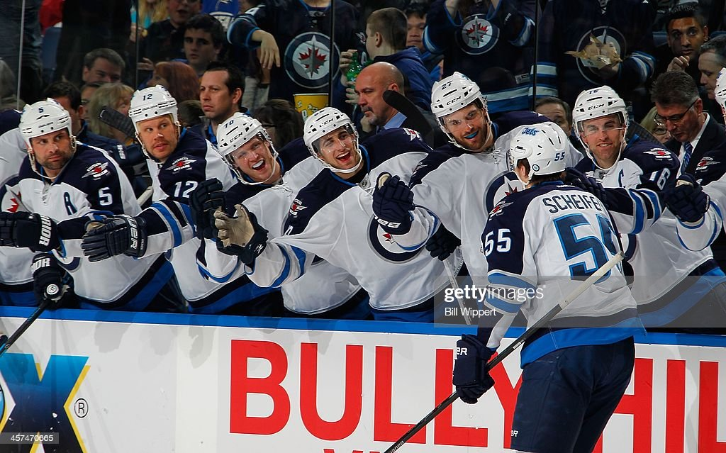 <a gi-track='captionPersonalityLinkClicked' href=/galleries/search?phrase=Mark+Scheifele&family=editorial&specificpeople=7342540 ng-click='$event.stopPropagation()'>Mark Scheifele</a> #55 of the Winnipeg Jets celebrates his second goal of the game against the Buffalo Sabres on December 17, 2013 at the First Niagara Center in Buffalo, New York. Buffalo won, 4-2.