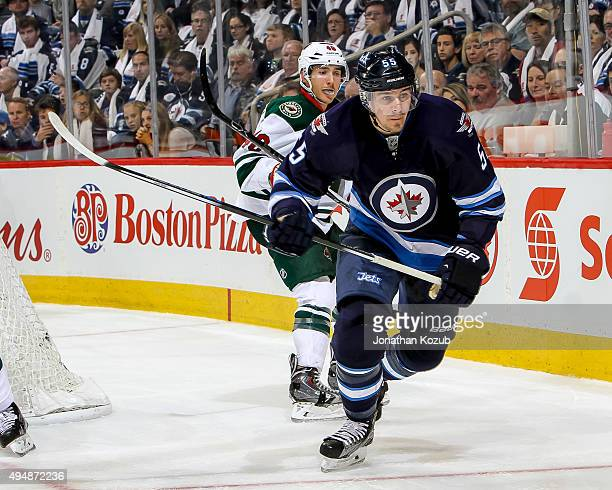 Mark Scheifele of the Winnipeg Jets follows the play around the boards during third period action against the Minnesota Wild at the MTS Centre on...