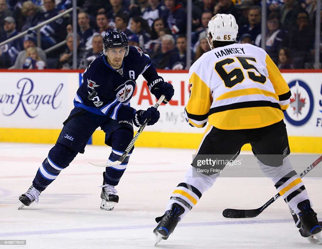 Mark Scheifele #55 of the Winnipeg Jets follows the play down the ice as Ron Hainsey #65 of the Pittsburgh Penguins defends during third period action at the MTS Centre on March 8, 2017 in Winnipeg, Manitoba, Canada.