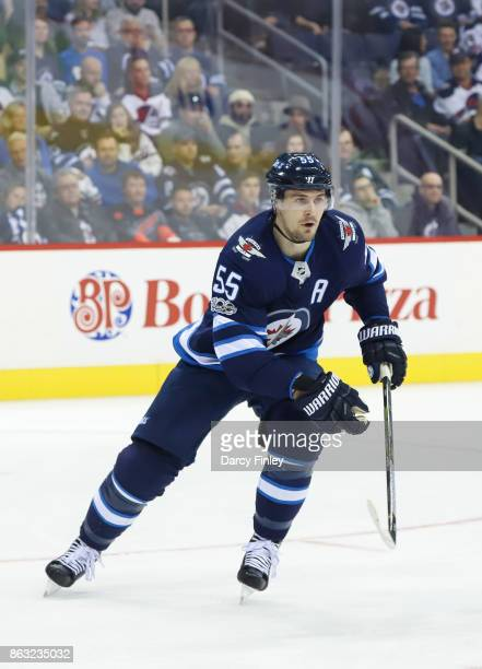 Mark Scheifele of the Winnipeg Jets follows the play down the ice during first period action against the Carolina Hurricanes at the Bell MTS Place on...