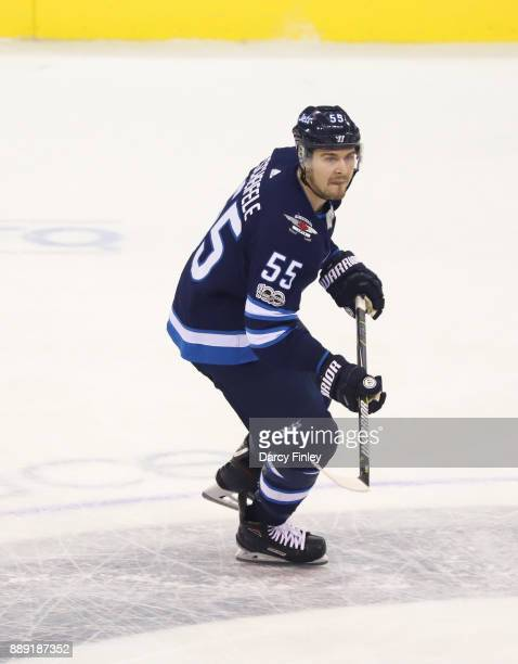 Mark Scheifele of the Winnipeg Jets follows the play down the ice during second period action against the Ottawa Senators at the Bell MTS Place on...
