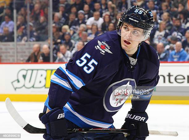 Mark Scheifele of the Winnipeg Jets gets set for a third period faceoff against the Minnesota Wild on December 29 2014 at the MTS Centre in Winnipeg...