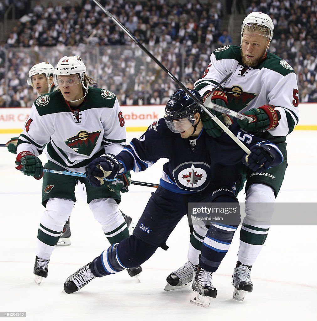 Mark Scheifele #55 of the Winnipeg Jets gets tangled up with Christian Folin #5 of the Minnesota Wild in second period action in an NHL game at the MTS Centre on October 25, 2015 in Winnipeg, Manitoba, Canada.