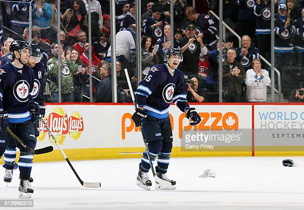 Mark Scheifele of the Winnipeg Jets is all smiles as he skates to the bench after scoring his first career NHL hat trick during third period action...