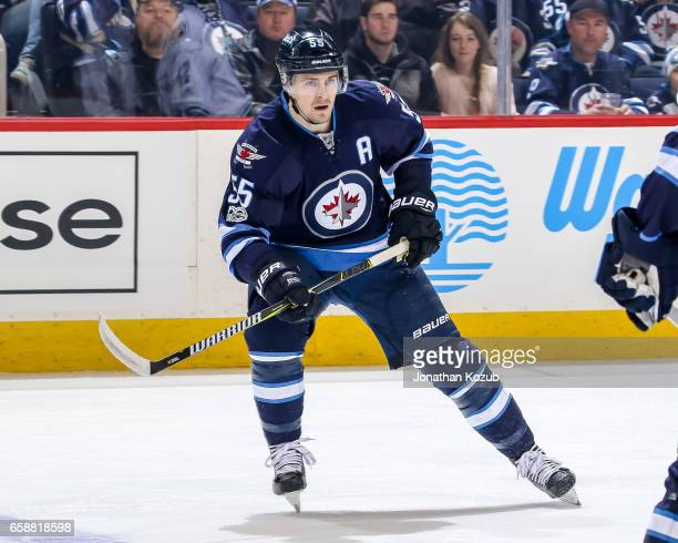 Mark Scheifele of the Winnipeg Jets keeps an eye on the play during first period action against the Vancouver Canucks at the MTS Centre on March 26...