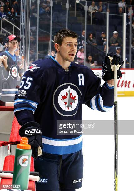 Mark Scheifele of the Winnipeg Jets looks on during the pregame warm up prior to NHL action against the Vancouver Canucks at the MTS Centre on March...