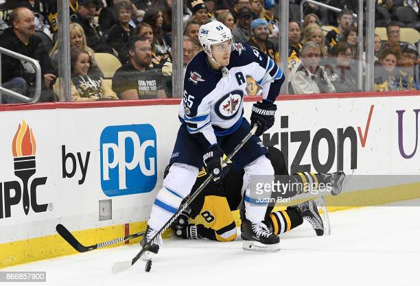 Mark Scheifele of the Winnipeg Jets looks to make a play with the puck in front of Brian Dumoulin of the Pittsburgh Penguins in the third period...