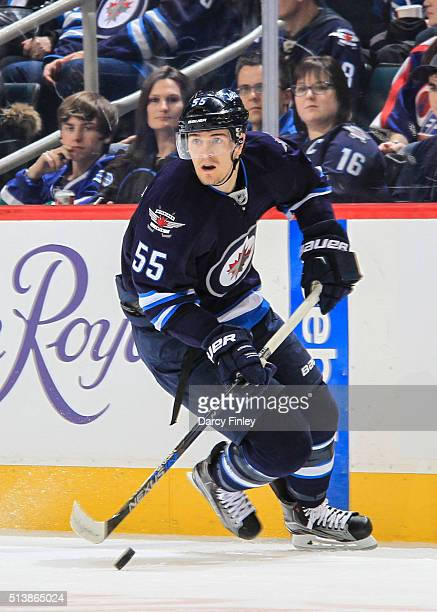Mark Scheifele of the Winnipeg Jets plays the puck down the ice during first period action against the Florida Panthers at the MTS Centre on March 1...