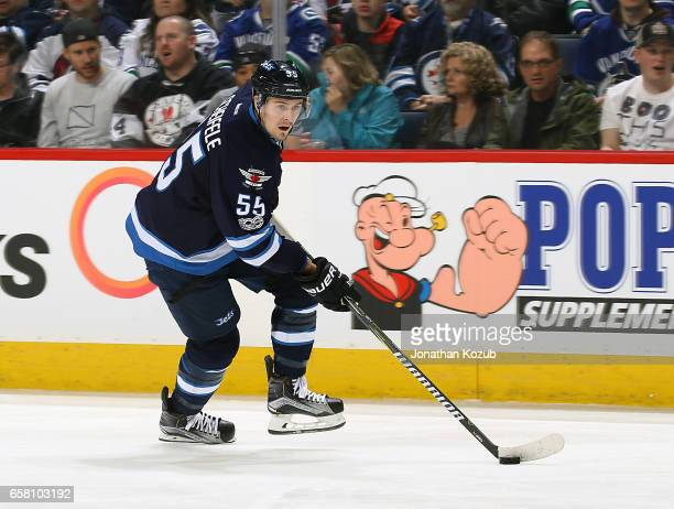 Mark Scheifele of the Winnipeg Jets plays the puck up the ice during first period action against the Vancouver Canucks at the MTS Centre on March 26...