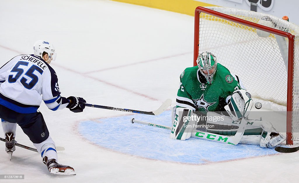 Mark Scheifele #55 of the Winnipeg Jets scores a goal against Kari Lehtonen #32 of the Dallas Stars in the third period at American Airlines Center on February 25, 2016 in Dallas, Texas.