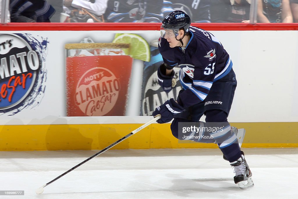 <a gi-track='captionPersonalityLinkClicked' href=/galleries/search?phrase=Mark+Scheifele&family=editorial&specificpeople=7342540 ng-click='$event.stopPropagation()'>Mark Scheifele</a> #55 of the Winnipeg Jets skates up the ice during second period action against the Ottawa Senators at the MTS Centre on January 19, 2013 in Winnipeg, Manitoba, Canada. The Senators defeated the Jets 4-1.