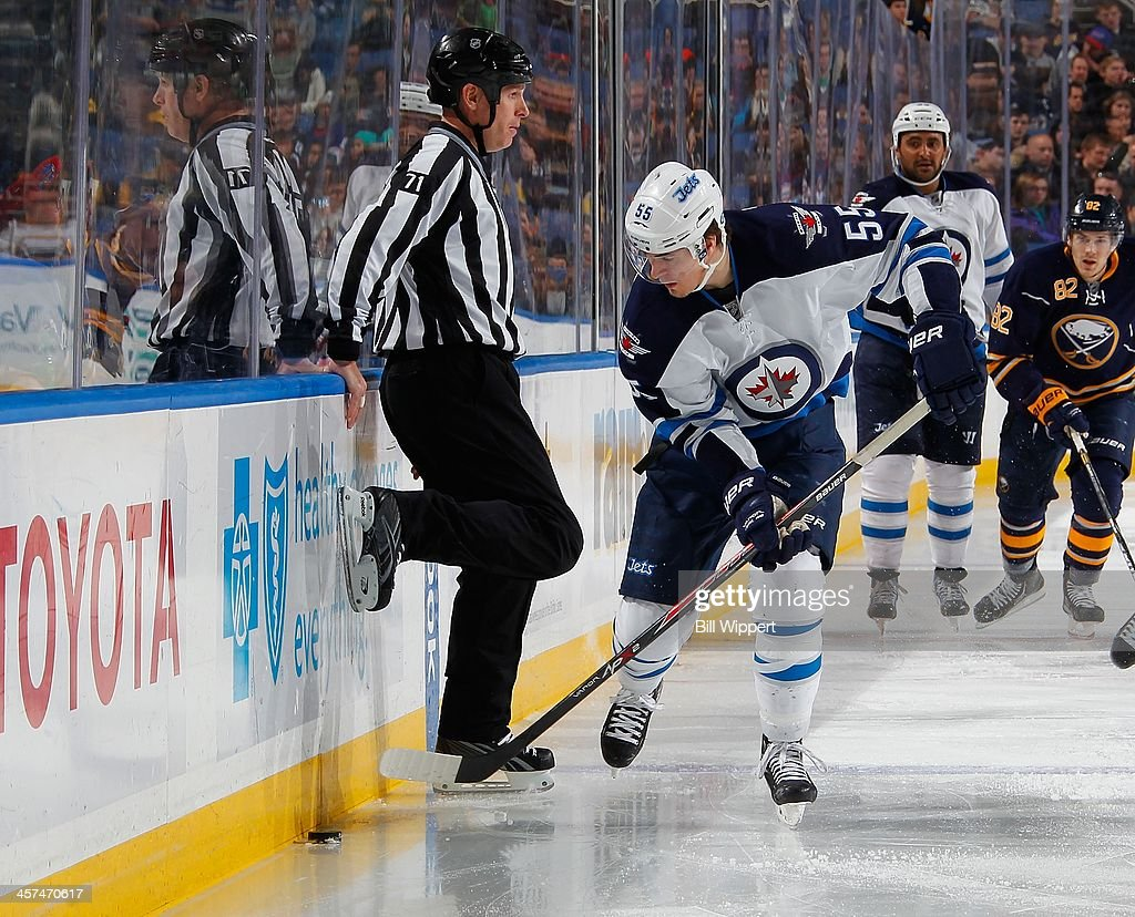 <a gi-track='captionPersonalityLinkClicked' href=/galleries/search?phrase=Mark+Scheifele&family=editorial&specificpeople=7342540 ng-click='$event.stopPropagation()'>Mark Scheifele</a> #55 of the Winnipeg Jets stickhandles around linesman Brad Kovachik #71 in a game against the Buffalo Sabres on December 17, 2013 at the First Niagara Center in Buffalo, New York. Buffalo won, 4-2.
