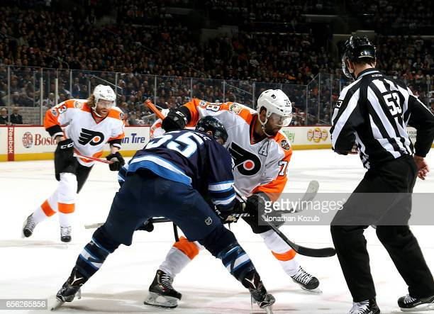 Mark Scheifele of the Winnipeg Jets takes a first period faceoff against PierreEdouard Bellemare of the Philadelphia Flyers at the MTS Centre on...