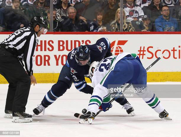Mark Scheifele of the Winnipeg Jets takes a first period faceoff against Henrik Sedin of the Vancouver Canucks at the MTS Centre on March 26 2017 in...