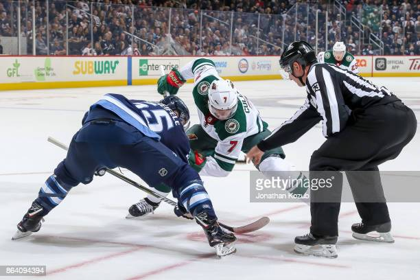 Mark Scheifele of the Winnipeg Jets takes a first period faceoff against Matt Cullen of the Minnesota Wild at the Bell MTS Place on October 20 2017...