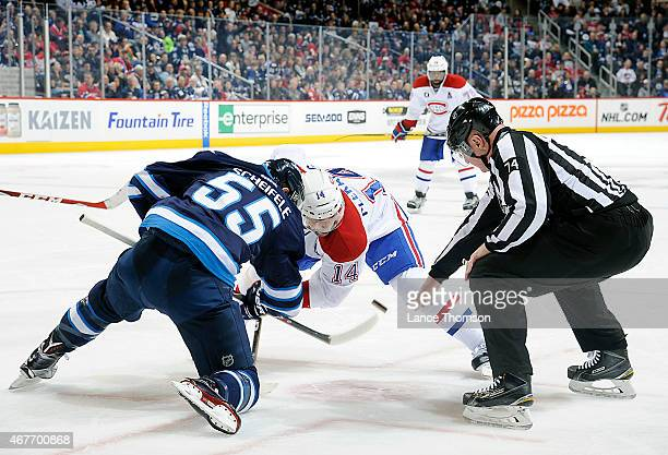 Mark Scheifele of the Winnipeg Jets takes a third period faceoff against Tomas Plekanec of the Montreal Canadiens on March 26 2015 at the MTS Centre...