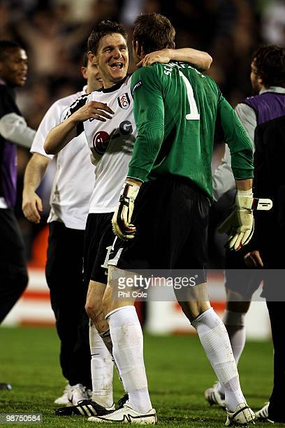 Mark Schwarzer and Zoltan Gera of Fulham celebrate victory after the UEFA Europa League SemiFinal 2nd leg match between Fulham and Hamburger SV at...