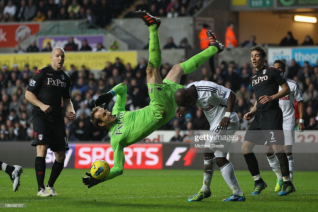 <a gi-track='captionPersonalityLinkClicked' href=/galleries/search?phrase=Mark+Schwarzer&family=editorial&specificpeople=208085 ng-click='$event.stopPropagation()'>Mark Schwarzer</a> goalkeeper of Fulham is airborne after taking a catch above <a gi-track='captionPersonalityLinkClicked' href=/galleries/search?phrase=Leroy+Lita&family=editorial&specificpeople=661193 ng-click='$event.stopPropagation()'>Leroy Lita</a> (R) of Swansea City during the Barclays Premier League match between Swansea City and Fulham at the Liberty Stadium on December 10, 2011 in Swansea, Wales.