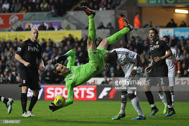 Mark Schwarzer goalkeeper of Fulham is airborne after taking a catch above Leroy Lita of Swansea City during the Barclays Premier League match...