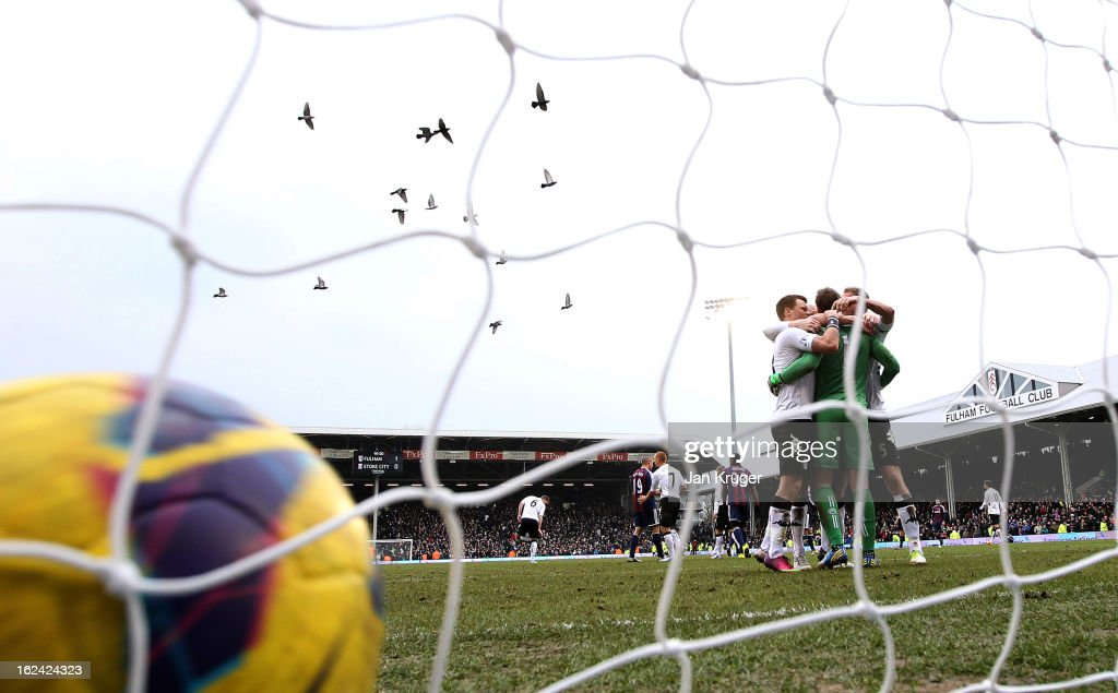 Mark Schwarzer, Goalkeeper of Fulham is embraced by team mates after the final whistle during the Barclays Premier League match between Fulham and Stoke City at Craven Cottage on February 23, 2013 in London, England.