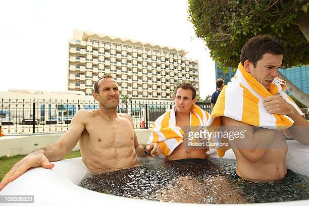Mark Schwarzer Luke Wiltshire and Matt McKay sit in an ice bath during an Australian Socceroos recovery session at the Marriott Hotel on January 26...