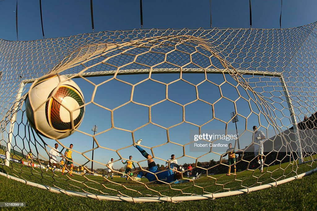 Mark Schwarzer of Australia is beaten by a shot from Herculez Gomez of the USA during the International Friendly between the Australian Socceroos and the USA at Ruimsig Stadium on June 5, 2010 in Roodepoort, South Africa.