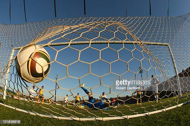 Mark Schwarzer of Australia is beaten by a shot from Herculez Gomez of the USA during the International Friendly between the Australian Socceroos and...