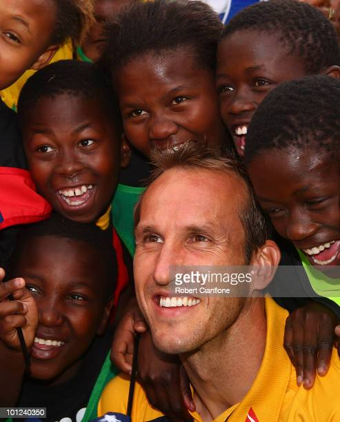 Mark Schwarzer of Australia poses with local school children at a soccer clinic after an Australian Socceroos training session at St Stithians...