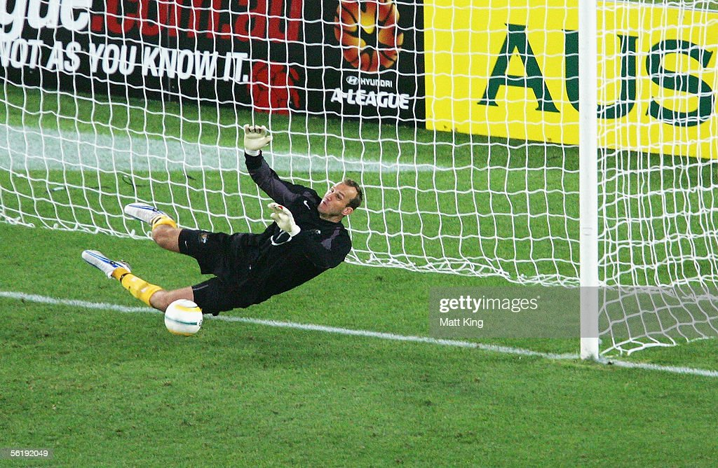 Mark Schwarzer of Australia saves a goal in the penalty shoot-out during the second leg of the 2006 FIFA World Cup qualifying match between Australia and Uruguay at Telstra Stadium November 16, 2005 in Sydney, Australia.