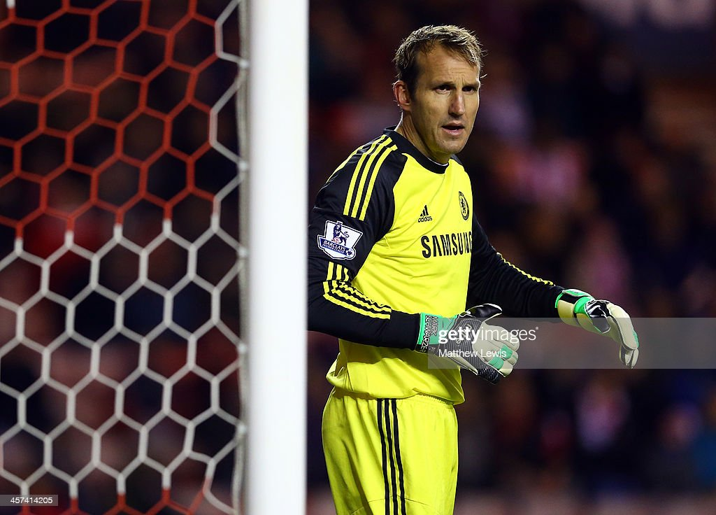 <a gi-track='captionPersonalityLinkClicked' href=/galleries/search?phrase=Mark+Schwarzer&family=editorial&specificpeople=208085 ng-click='$event.stopPropagation()'>Mark Schwarzer</a> of Chelsea looks on during the Capital One Cup Quarter-Final match between Sunderland and Chelsea at Stadium of Light on December 17, 2013 in Sunderland, England.