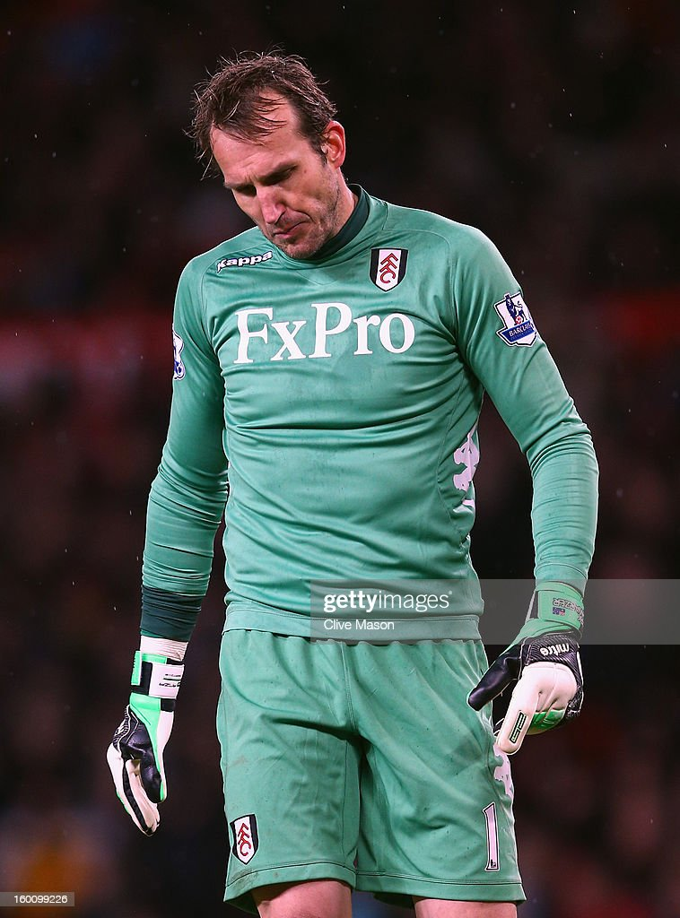 Mark Schwarzer of Fulham looks dejected during the FA Cup with Budweiser Fourth Round match between Manchester United and Fulham at Old Trafford on January 26, 2013 in Manchester, England.