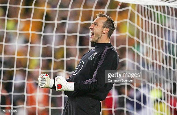 Mark Schwarzer of the Socceroos celebrates saving a goal during the penalty shootout the second leg of the 2006 FIFA World Cup qualifying match...