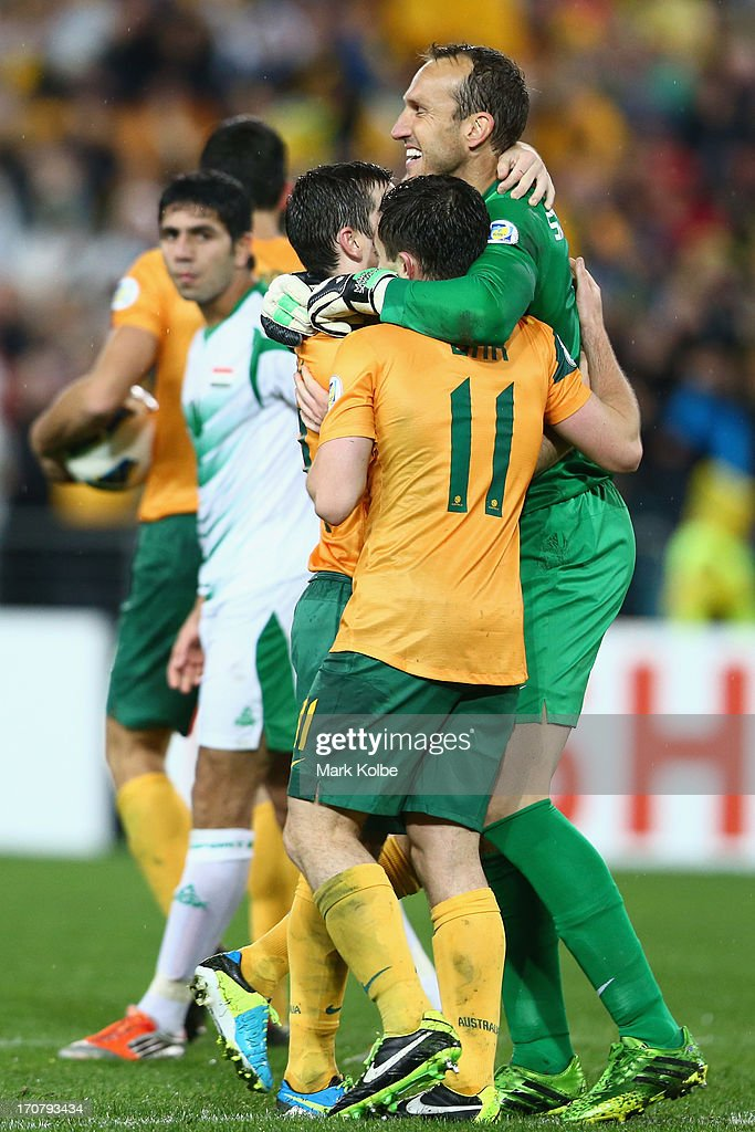 <a gi-track='captionPersonalityLinkClicked' href=/galleries/search?phrase=Mark+Schwarzer&family=editorial&specificpeople=208085 ng-click='$event.stopPropagation()'>Mark Schwarzer</a> of the Socceroos celebrates victory with his team mates after the FIFA 2014 World Cup Asian Qualifier match between the Australian Socceroos and Iraq at ANZ Stadium on June 18, 2013 in Sydney, Australia.