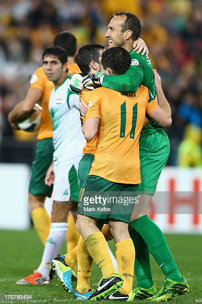Mark Schwarzer of the Socceroos celebrates victory with his team mates after the FIFA 2014 World Cup Asian Qualifier match between the Australian...