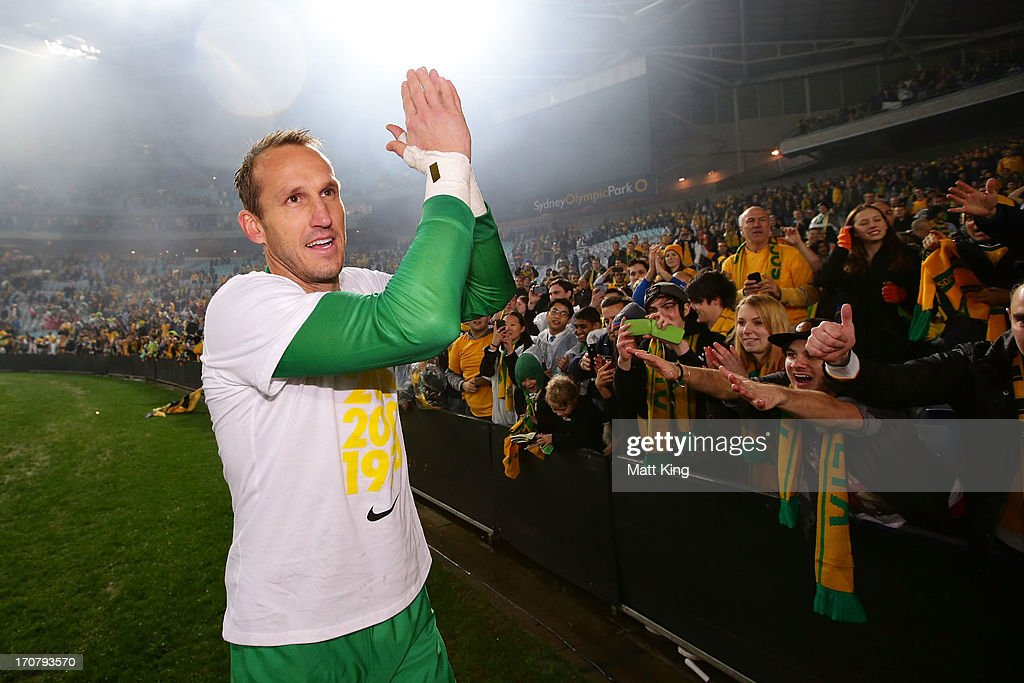 <a gi-track='captionPersonalityLinkClicked' href=/galleries/search?phrase=Mark+Schwarzer&family=editorial&specificpeople=208085 ng-click='$event.stopPropagation()'>Mark Schwarzer</a> of the Socceroos celebrates with fans after the FIFA 2014 World Cup Asian Qualifier match between the Australian Socceroos and Iraq at ANZ Stadium on June 18, 2013 in Sydney, Australia.