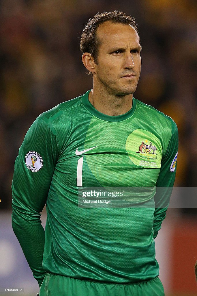 <a gi-track='captionPersonalityLinkClicked' href=/galleries/search?phrase=Mark+Schwarzer&family=editorial&specificpeople=208085 ng-click='$event.stopPropagation()'>Mark Schwarzer</a> of the Socceroos stands for the National Anthem before the FIFA World Cup Qualifier match between the Australian Socceroos and Jordan at Etihad Stadium on June 11, 2013 in Melbourne, Australia.