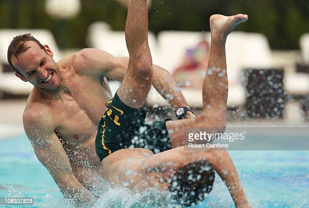 Mark Schwarzer throws Matt McKay into the pool during an Australian Socceroos recovery session at the Marriott Hotel on January 26 2011 in Doha Qatar