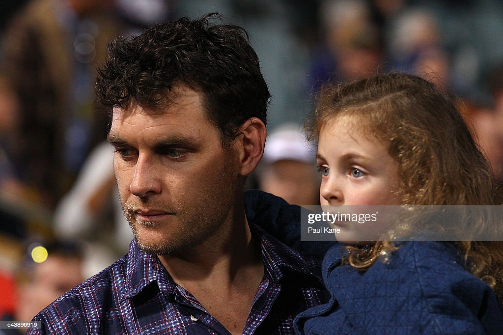 <a gi-track='captionPersonalityLinkClicked' href=/galleries/search?phrase=Mark+Seaby&family=editorial&specificpeople=221164 ng-click='$event.stopPropagation()'>Mark Seaby</a> looks on with his daughter before walking a lap of honour with team mates celebrating the West Coast Eagles 2006 Premiership anniversary during the round 15 AFL match between the West Coast Eagles and the Essendon Bombers at Domain Stadium on June 30, 2016 in Perth, Australia.