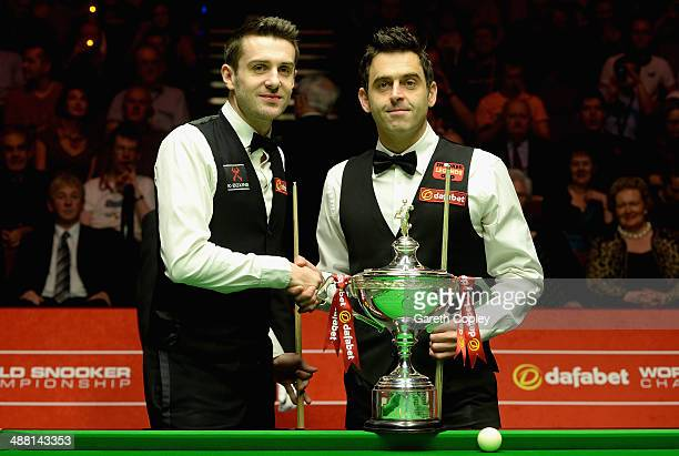 Mark Selby and Ronnie O'Sullivan shake hands ahead of The Dafabet World Snooker Championship final at Crucible Theatre on May 4 2014 in Sheffield...