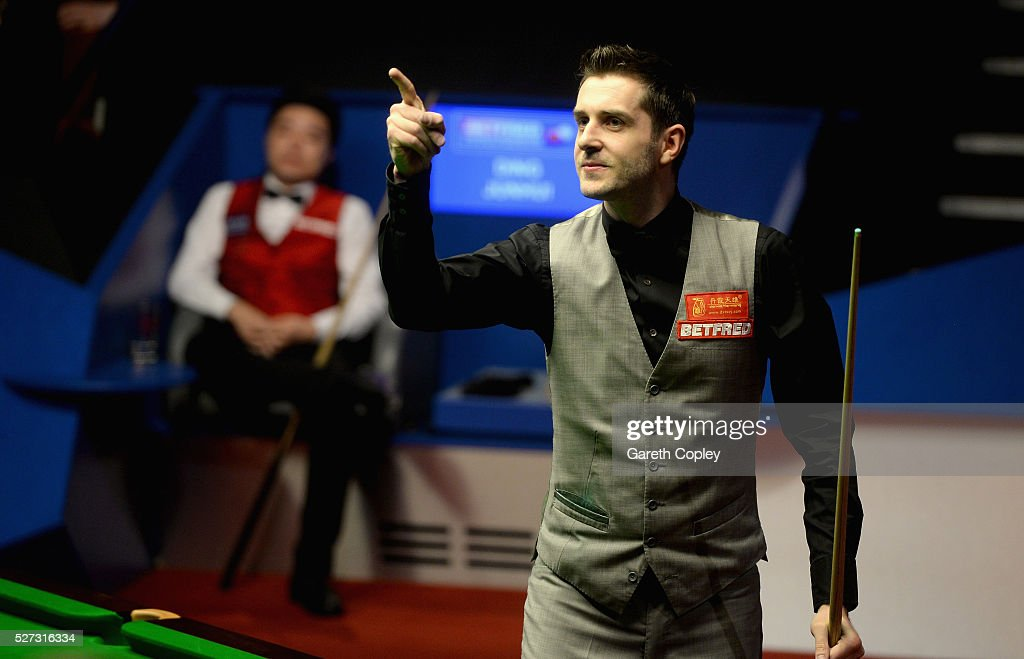 Mark Selby celebrates potting frame ball to beat Ding Junhui to win the World Snooker Championship final at the Crucible Theatre on May 02 2016 in...