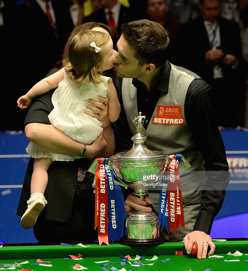 <a gi-track='captionPersonalityLinkClicked' href=/galleries/search?phrase=Mark+Selby&family=editorial&specificpeople=676444 ng-click='$event.stopPropagation()'>Mark Selby</a> celebrates with wife Vikki and daughter Sofia after lifting the trophy after beating Ding Junhui to win the World Snooker Championship final at the Crucible Theatre on May 02, 2016 in Sheffield, England.