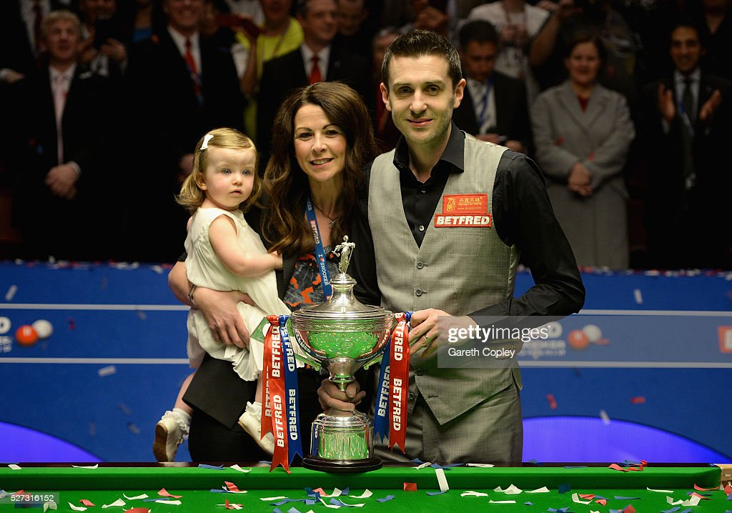 Mark Selby celebrates with wife Vikki and daughter Sofia after lifting the trophy after beating Ding Junhui to win the World Snooker Championship...