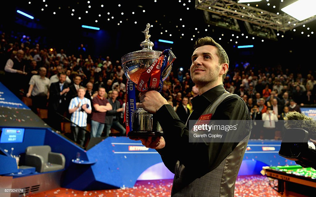 Mark Selby lifts the trophy after beating Ding Junhui to win the World Snooker Championship final at the Crucible Theatre on May 02, 2016 in Sheffield, England.