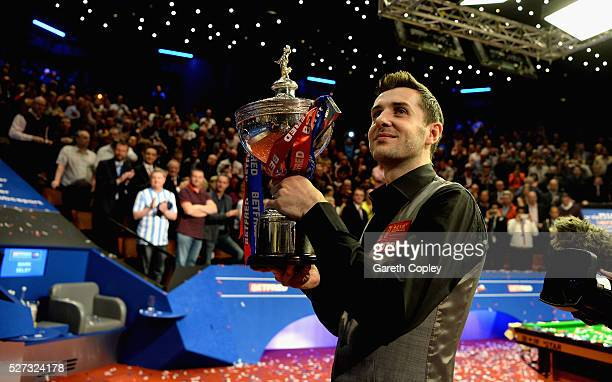 Mark Selby lifts the trophy after beating Ding Junhui to win the World Snooker Championship final at the Crucible Theatre on May 02 2016 in Sheffield...