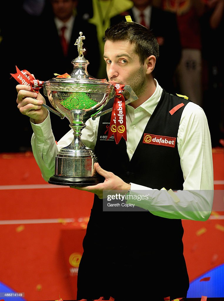 Mark Selby lifts the trophy after winning The Dafabet World Snooker Championship final at Crucible Theatre on May 5 2014 in Sheffield England
