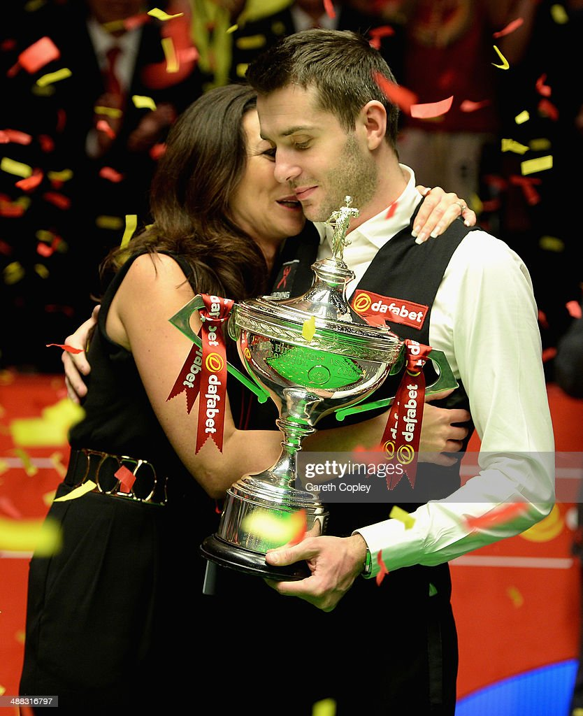 <a gi-track='captionPersonalityLinkClicked' href=/galleries/search?phrase=Mark+Selby&family=editorial&specificpeople=676444 ng-click='$event.stopPropagation()'>Mark Selby</a> lifts the trophy with wife Vikki after winning The Dafabet World Snooker Championship final at Crucible Theatre on May 5, 2014 in Sheffield, England.