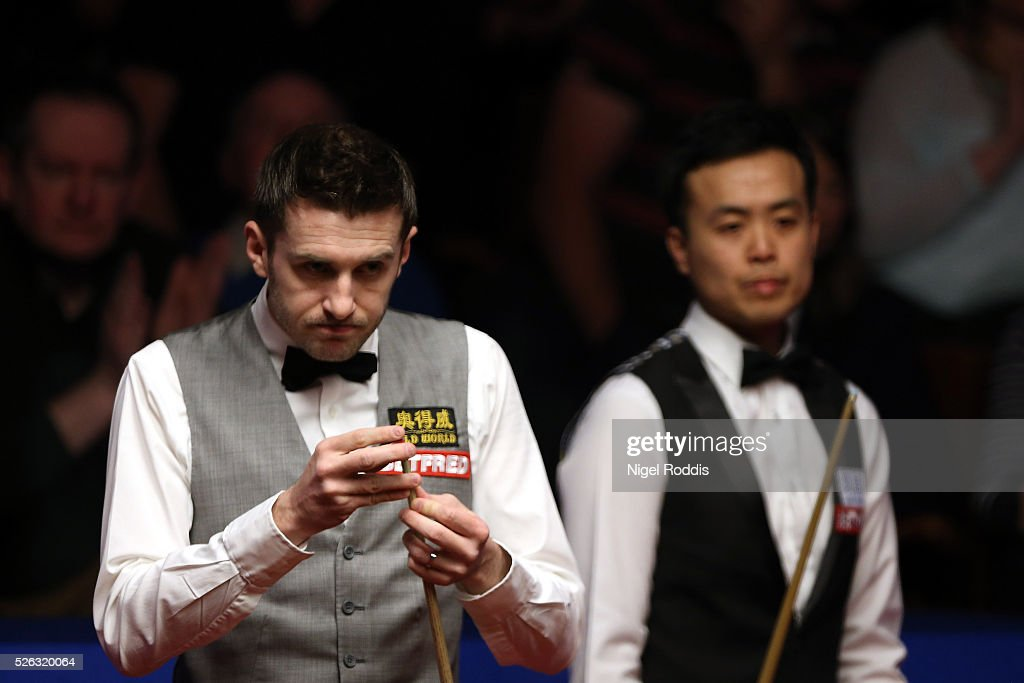 <a gi-track='captionPersonalityLinkClicked' href=/galleries/search?phrase=Mark+Selby&family=editorial&specificpeople=676444 ng-click='$event.stopPropagation()'>Mark Selby</a> (L) of England and <a gi-track='captionPersonalityLinkClicked' href=/galleries/search?phrase=Marco+Fu&family=editorial&specificpeople=221154 ng-click='$event.stopPropagation()'>Marco Fu</a> of Hong Kong during their semi final match against on day fifteen of the World Championship Snooker at Crucible Theatre on April 30, 2016 in Sheffield, England.