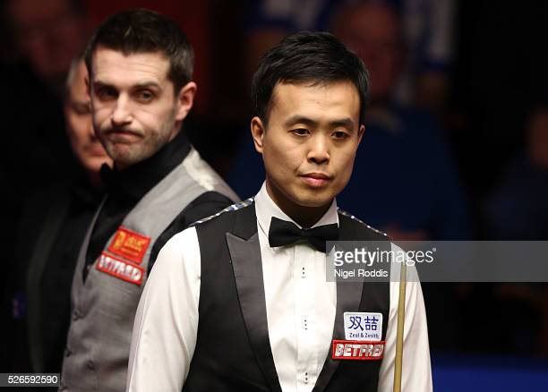 Mark Selby of England and Marco Fu of Hong Kong during their semi final match against on day fifteen of the World Championship Snooker at Crucible...