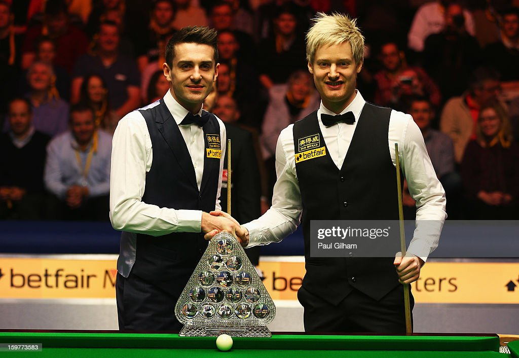 Mark Selby of England and Neil Robertson of Australia pose together with The Masters Trophy prior to the start of The Masters Final between Mark...